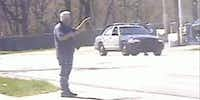 Police in Michigan spent 40 minutes talking down Joseph Houseman, who stood with a rifle on a street.