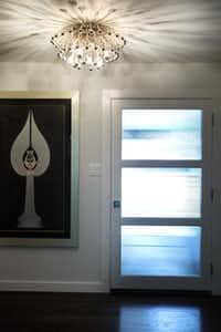 The Anemone ceiling lamp in the home's entry was found on jonathanadler.com via Houzz.