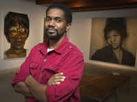 """Artist Sedrick Huckaby poses with paintings of his mother, left, Ruthie Huckaby and his grandmother who he calls """"Big Mamma"""" at the Valley House Gallery in Dallas, Wednesday, Dec. 4, 2013."""