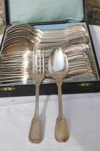 Vintage set of 1920s French spoons and forks in a box lined with blue silk( Audrey Feldman )