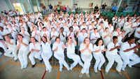 Women inmates at the Christina Melton Crain Unit cheer after a performance by The Catdaddies, a rock garage band in which Crain is a vocalist.(Photo submitted by CHRISTINA MELTON CRAIN)