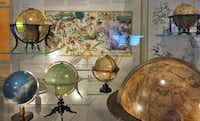 Globes of all descriptions line the shelves of the museum.( Susan Farlow  -  Special Contributor )
