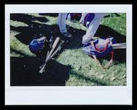 Texas Rangers spring training 2015: Bats, helmets and other gear sit on the ground during a workout at the Texas Rangers spring training facility in Surprise, Arizona. (Andy Jacobsohn/The Dallas Morning News)