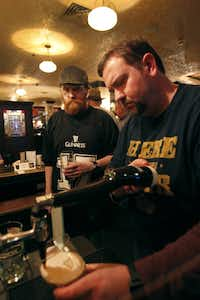 """John Haughey and Richard Willemin enjoyed glasses of Guinness at """"Pour Your Own Pint Night"""" at Trinity Hall pub."""