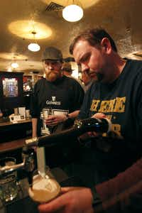 "John Haughey and Richard Willemin enjoyed glasses of Guinness at ""Pour Your Own Pint Night"" at Trinity Hall pub."