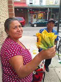 "Reyna Trinidad Morales, a vendor in Philadelphia, said, ""El papa's message is about love, peace and humility.""(Alfredo Corchado -  Staff  )"