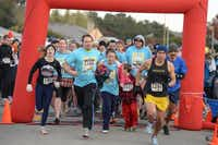 Blake Kennedy (No. 1166) and Alberto Castro (No. 1291) lead a pack of runners at the beginning of the Thanks Giving Hope 5K run on Nov. 28 at Campbell Green Park in Far North Dallas.Photos submitted by ANGELA LOWRY PHOTOGRAPHY