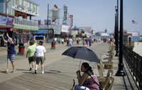 People-watching is a year-round sport on the boardwalks, which have been rebuilt after Superstorm Sandy.( Mel Evans  -  The Associated Press )