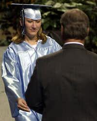 """Jessica McClure, known to the world as """"Baby Jessica,"""" receives her high school diploma in May of 2004 at Greenwood High School near Midland, Texas."""