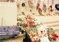 Flowers and tributes lined Dealey Plaza in the days and weeks after the assassination of President John F. Kennedy.Photo submitted by TIM GOLLOB