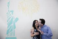 Phillip Stromberg kisses his wife, Julieta Chiquillo, after she became a U.S. citizen on Thursday. (Rose Baca/The Dallas Morning News)