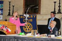 Kass Prince, left, presents a joke parting gift to Irving Chamber President Chris Wallace at the Irving Rotary Club meeting.Photo submitted by IRVING ROTARY CLUB