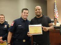 Wendell Williams (right) presented firefighter and paramedic Daniel Kennedy (left) and the other first responders — Capt. Brent Shull and firefighters/paramedics Alvin Skelton, Gary Blaser and Tye Baudin — with Life-Saving Awards at the May 5 DeSoto City Council meeting.( Photo courtesy of the DeSoto Fire Department )