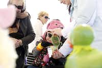 Emerson Sieling (center) cast her vote for a ducky decorated as Kermit the Frog, assisted by (from left) Catherine Head and Shannon Coffman, at Ducky Palooza.