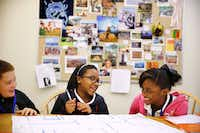 Sixth-grade math students (from left) Caleb Smith, Kendacia Combs and Tiavionne Brazile share a laugh while working on a project to map out a new building.