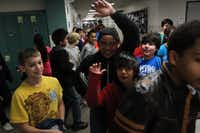 Student swarm the halls on their way to lunch at Staley Middle School in Frisco.