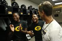 Jeff Jordan, head football coach at Garland High School, laughs with Devonte Hayden, left, and Grant Garth, in the locker room before a football practice at Williams Stadium in Garland, Texas, Thursday, Aug. 22, 2013. Coach Jordan says he has noticed that athletes who are striving to build muscle, but are not getting results, often are not getting enough sleep.