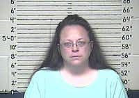 """""""God's moral law conflicts with my job duties,"""" Rowan County Clerk Kim Davis said in her contempt hearing.( Carter County Detention Center  - AP)"""