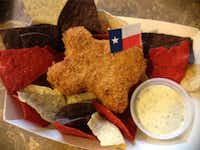 Deep Fried King Ranch Casserole is Texas shaped and served over red, white and blue tortilla chips.