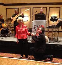 Sean Mitchell sings Happy Birthday to Kitty Baker at her 80th birthday party.Staff photo by DEBORAH FLECK