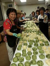 Preparing homemade food for the Korean Festival on June 28 at New Song Church in Carrollton.Courtesy