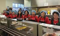Members of the Korean American Women's Association of Dallas serve Korean food at Center of Hope in Dallas.( Korean American Women's Association of Dallas )