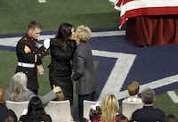 Taya Kyle returns to her seat after speaking about her husband Chris Kyle during a memorial service for Chris Kyle at Cowboys Stadium in Arlington on February 11, 2013.