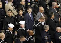 Sarah Palin and  husband Todd Palin (center) waits to exit the field during a memorial service for Chris Kyle at Cowboys Stadium in Arlington on February 11, 2013.