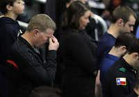 A man gets emotional during a prayer at a memorial service for Chris Kyle at Cowboys Stadium in Arlington on February 11, 2013.