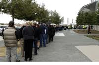 Hundreds of people wait in line to attend the memorial service for former Navy SEAL Chris Kyle on Monday, February 11, 2013 at Cowboys Stadium in Arlington, Texas.