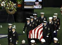 Military members carry the body of former Navy SEAL Chris Kyle after the memorial service on Monday, February 11, 2013 at Cowboys Stadium in Arlington, Texas.