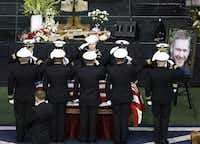 An honor guard saluted Chris Kyle during the memorial service for the former Navy SEAL at Cowboys Stadium.