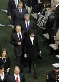 Dallas Cowboys owner and general manager Jerry Jones and family (from front to back) Gene Jones, Stephen Jones and Jerry Jones Jr., exit the field after a memorial service for Chris Kyle at Cowboys Stadium in Arlington on February 11, 2013.