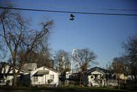 A pair of shoes hang from the power lines in the La Bajada neighborhood in West Dallas, Wednesday, December 16, 2015. A new CVS Pharmacy is proposed nearby at the corner of Singleton Blvd and Sylvan Ave. Around the corner, lots which the owners are encouraging CVS to buy would pierce the La Bajada neighborhood overlay, which aims to protect the character of the single-family, down to earth neighborhood just north of Trinity Groves. (Tom Fox/The Dallas Morning News)