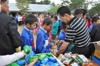 At an orphanage school last year in Luang Prabang, Laos, Pastor H handed out bags with such things as ramen cups and soap. He said he remembered 40 years ago, when he, too, held out his hands to food.(Courtesy photo - First Laotian Baptist Church)