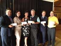 Doug Fox (from left), Crystal Scanio, Teddie Story, Ron Woolard, John Drake and Chris Allen receive checks on behalf of their Irving charities. Woolard of Las Colinas Country Club made the presentation.Staff photo by DEBORAH FLECK  -  DMN