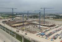 Liberty Mutual's two-tower campus is under construction on the west side of the tollway. (KDC)