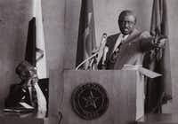 This undated photo shows Al Lipscomb engrossed in a speech by legendary Grambling State University football coach Eddie Robinson.