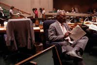 """Al Libscomb turns his back on a Ku Klux Klan member who was voicing opposition to a proposed AIDS anti-discrimination ordinance before the Dallas City Council during a January 1989 meeting. """"Oh, was there somebody up there?"""" Lipscomb replied later when asked if he intentionally turned away."""