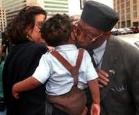 Dallas City Council member Al Lipscomb kisses his grandson, Albert Louis Lipscomb III, after leaving the Earl Cabell Federal Building in March 1999. Lipscomb had just turned himself in on federal conspiracy and bribery charges.