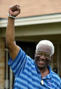 Former Dallas City Council member Al Lipscomb greets neighbors with a fist raised in celebration in July 2002 after his 2000 conviction on federal bribery and conspiracy charges was overturned.