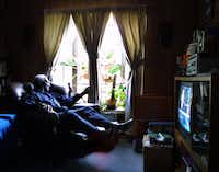 Former Dallas City council member Al Lipscomb looks out the window of his home in June 2002, when he was more than halfway through a 41-month home-confinement sentence on federal bribery and conspiracy charges. His conviction was overturned the following month.