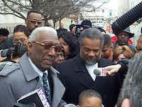Dallas City Councilman Al Lipscomb (left) talks to reporters in January 2000 outside the J. Marvin Jones Federal Building in Amarillo, where Lipscomb was on trial on bribery charges. At right is the Rev. Allan Madison, pastor of Lipscomb's church, St. Mark Baptist Church in Dallas.