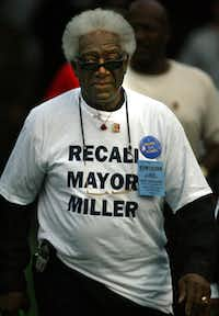Former Dallas City Council member Al Lipscomb shows his distaste for then-Mayor Laura Miller by wearing an anti-Miller T-shirt to the annual Prairie View A&M-Grambling football game at the Cotton Bowl in October 2003.