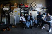 Al Lipscomb (second from left) joins Dallas residents James Brown, Anthony Brown and Norris Jones in March 2004 at a South Dallas tire shop to discuss issues surrounding the possibility of another Fair Park expansion.