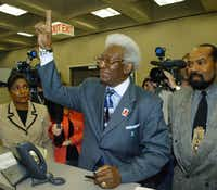 Former Dallas City Council member Al Lipscomb flashes the peace sign after filing in March 2005 to run for his old District 8 seat.