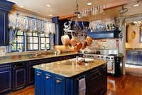 The spacious kitchen has royal blue cabinets.(Steve Reed)