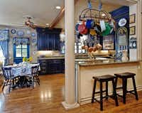 Warm woods back up against the kitchen for the home's eating space.(Dave Perry-Miller & Associates)