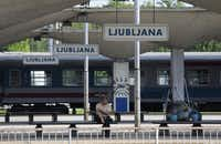 A passenger sits and waits on a platform at the main railway station in Ljubljana, Slovenia. You can get to Ljubljana by direct train from a few surrounding countries.