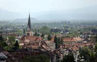 Buildings stand on the city skyline in the old town of Ljubljana, Slovenia.